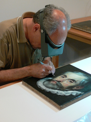 Gianfranco Pocobene takes cross-section of the museum's painting which is attributed to the Workshop of Peter Paul Rubens.